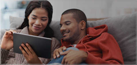 Picture of a couple looking at their tablet